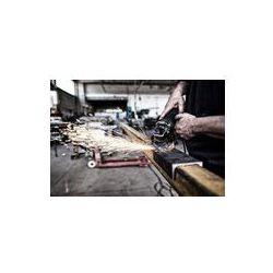 Foto naklejka samoprzylepna 100 x 100 cm - Człowiek pracy z kamieniem szlifierskim w fabryce