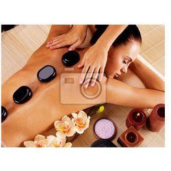 Obraz Adult kobieta o masaż gorącymi kamieniami w salonie spa