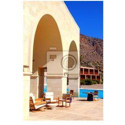 Fototapeta Hotelowy taras letni z basenem i meble ogrodowe (Grecja)
