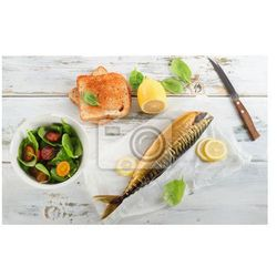 Obraz Smoked mackerel with lemon, toast and fresh salad.