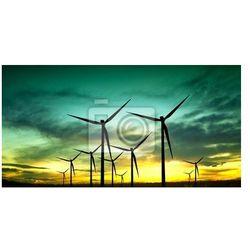 Obraz Turbiny wiatrowe sylwetka na zachodzie słońca